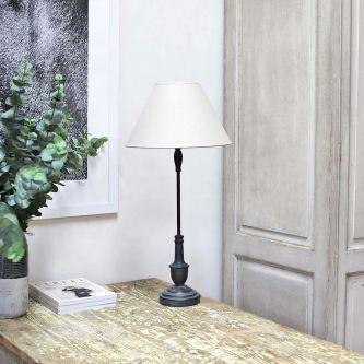 Dark Tall Metal Table Lamp with Linen Shade on a table.